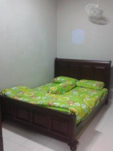A bed or beds in a room at Comfort Homestay