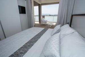 Cama o camas de una habitación en ApartHotel Playa Oliva