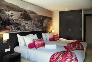 A bed or beds in a room at Appart'hotel Souani (Al Hoceima Bay)