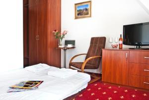 Łóżko lub łóżka w pokoju w obiekcie Villa Park