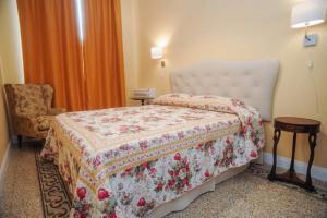 Letto o letti in una camera di Residenza Arrivabene