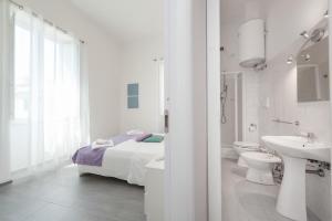 Un baño de Residenza Maxima