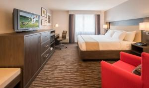 A television and/or entertainment center at Country Inn & Suites by Radisson, Rochester-Pittsford/Brighton, NY