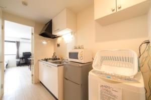 A kitchen or kitchenette at Kiyomizu Sannenzaka