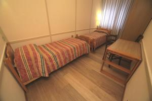 A bed or beds in a room at Appartamenti Bardonecchia