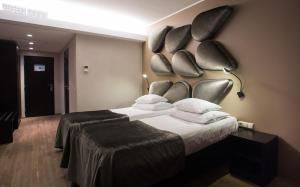 Voodi või voodid majutusasutuse Aqva Hotel & Spa toas