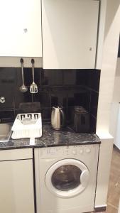 A kitchen or kitchenette at Slavija Square Apartment Cvetni Trg