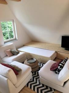 Ein Bett oder Betten in einem Zimmer der Unterkunft Ferienwohnung Müscher Bahnhof