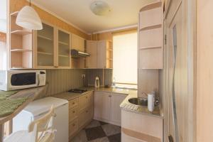 A kitchen or kitchenette at Guest House on Verkhne-Beregovaya
