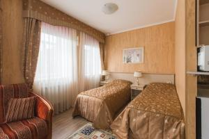 A bed or beds in a room at Guest House on Verkhne-Beregovaya