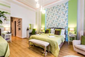 A bed or beds in a room at Makes You Happy Budapest