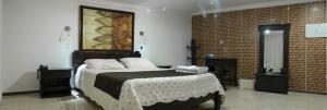 Кровать или кровати в номере Hotel Casa Morales