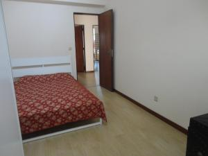 A bed or beds in a room at Apto paio-pires