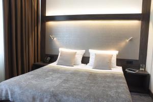 Postelja oz. postelje v sobi nastanitve Hotel Paka