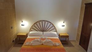Letto o letti in una camera di Villa Boschetto B&B - Apartments