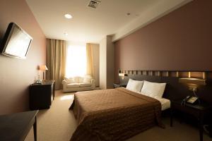 Un ou plusieurs lits dans un hébergement de l'établissement Hotel Imereti
