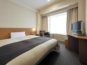 北九州皇冠飯店房間的床