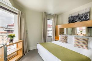 Cama ou camas em um quarto em Room Mate Alicia
