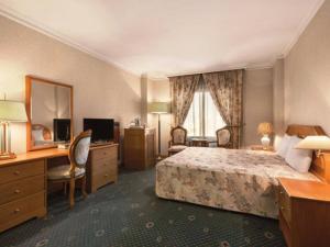 Кровать или кровати в номере Ramal Hotel Riggae Area