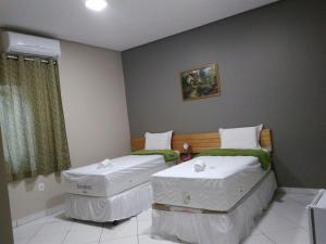 A bed or beds in a room at Greencity Hotel