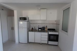 Una cocina o kitchenette en Aparthotel Aldea Termal