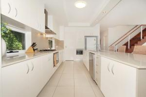 A kitchen or kitchenette at 60 Beachway Parade, Marcoola, 500 BOND, Linen supplied