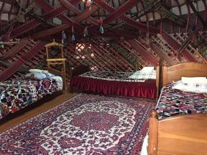 A bed or beds in a room at Jipek Joli Inn