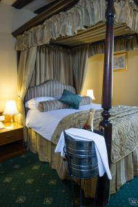 A bed or beds in a room at Prince Rupert Hotel