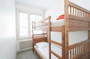 A bunk bed or bunk beds in a room at City-Appartements Nordkanalstraße contactless Check in