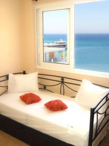 A bed or beds in a room at Dorana Apartments & Trekking Hotel