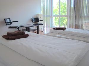 A bed or beds in a room at BNB Potsdamer Platz - Rooms & Apartments