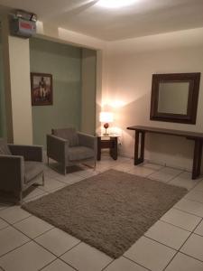 Uma área de estar em Hotel Conde Alemao