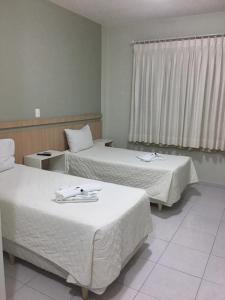Cama ou camas em um quarto em Hotel Conde Alemao