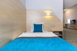 Łóżko lub łóżka w pokoju w obiekcie Hotel Vela