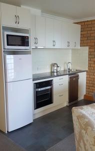A kitchen or kitchenette at Stanley Village Waterfront Accommodation