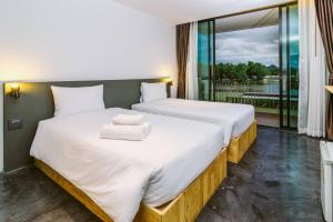 A bed or beds in a room at The Zeit River Kwai