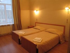 Кровать или кровати в номере Hotel Ligovskiy 44