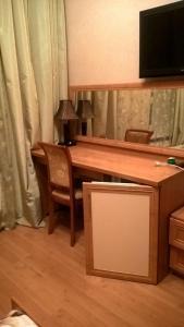 Телевизор и/или развлекательный центр в Hotel Ligovskiy 44