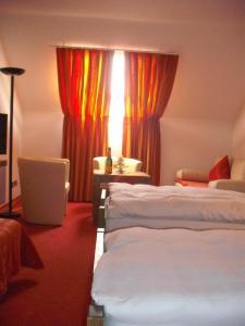 Ein Bett oder Betten in einem Zimmer der Unterkunft Alte Kelter