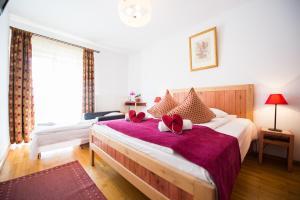 Postel nebo postele na pokoji v ubytování Villa Ermitage