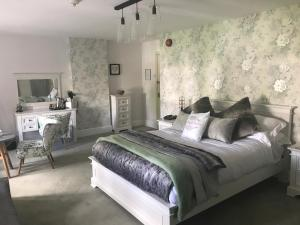 A bed or beds in a room at The Great House Hotel