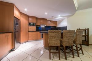 A kitchen or kitchenette at Paradise Penthouse at Waves - Airlie Beach
