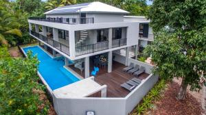 A view of the pool at The Port Douglas Beach House or nearby