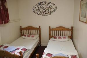 A bed or beds in a room at Kinlay House Dublin