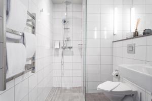 A bathroom at Biz Apartment Hammarby Sjöstad