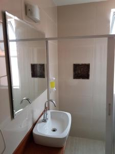 Um banheiro em Jucati Season Apartments