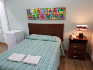 Cama ou camas em um quarto em Jucati Season Apartments