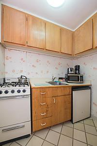 A kitchen or kitchenette at Murray Hill East Suites