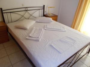 Ένα ή περισσότερα κρεβάτια σε δωμάτιο στο Ήλιος