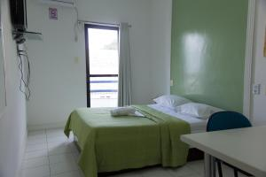 A bed or beds in a room at Hotel Serra Sol